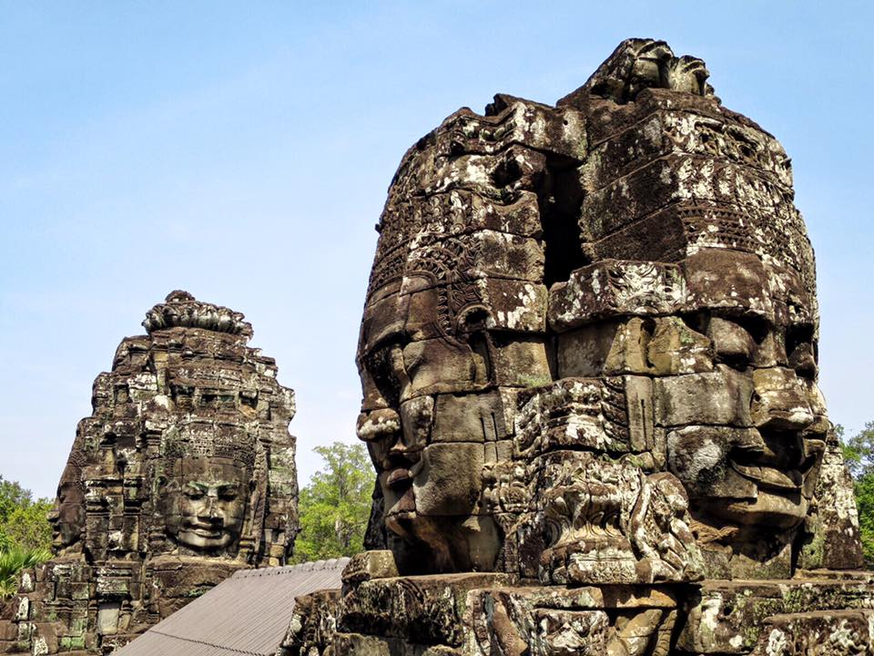 """The giant smiling faces at Bayon Temple in Angkor Wat. Even though there are over 200 faces in this ancient Buddhist temple, each one has its own unique facial features. Collectively, they're dubbed """"The Mona Lisa of Southeast Asia""""."""