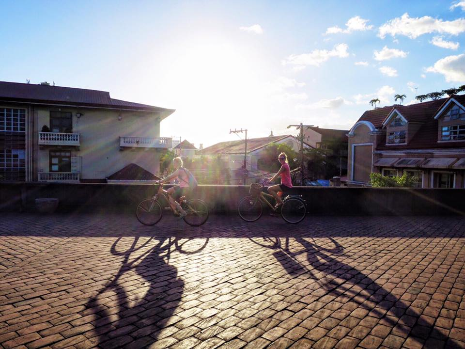 Bamboo-biking through Manila at the golden hour.