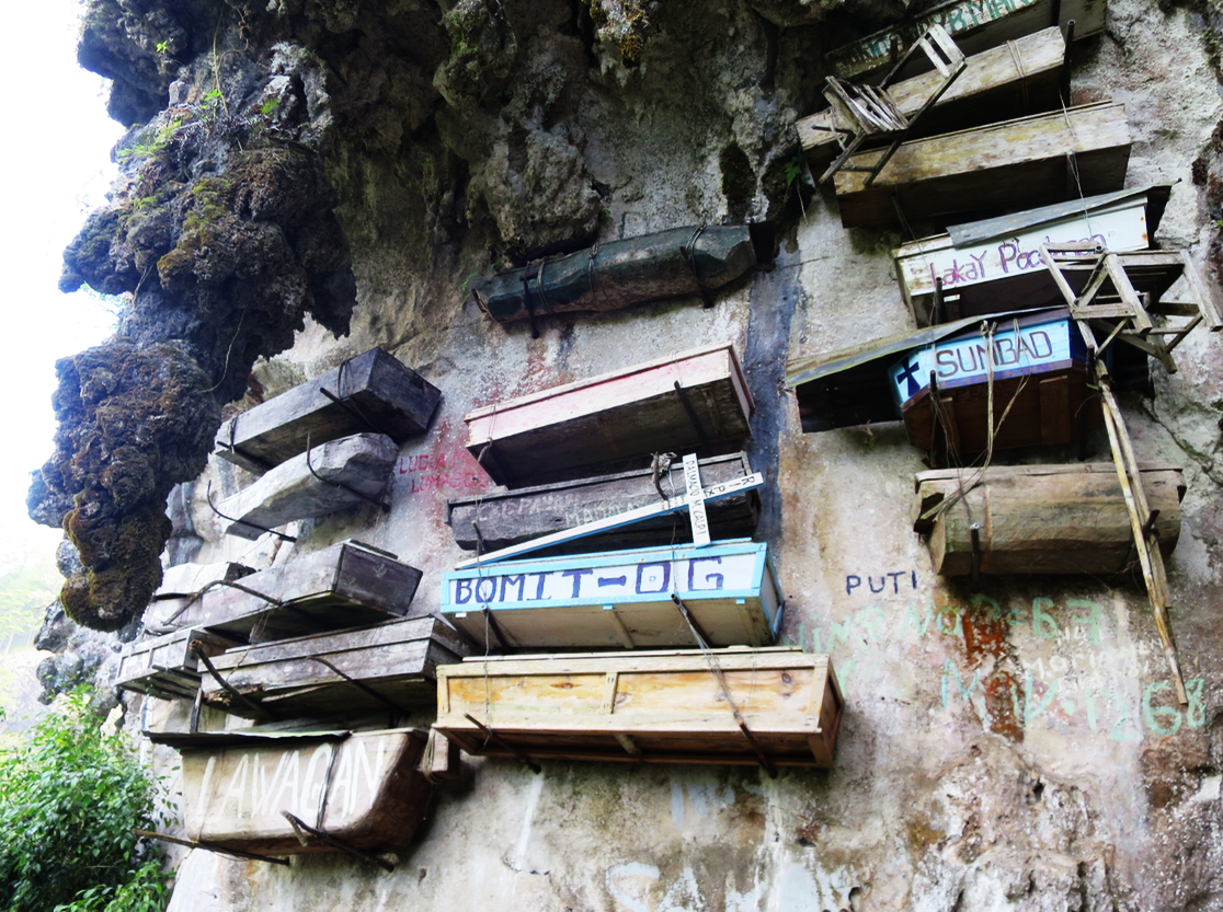 Hanging coffins along the cliff.
