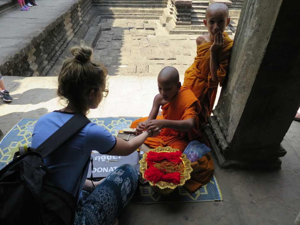 These little monks tied red bracelets to visitors' wrists. The bracelets are a reminder to show compassion in all aspects of life.