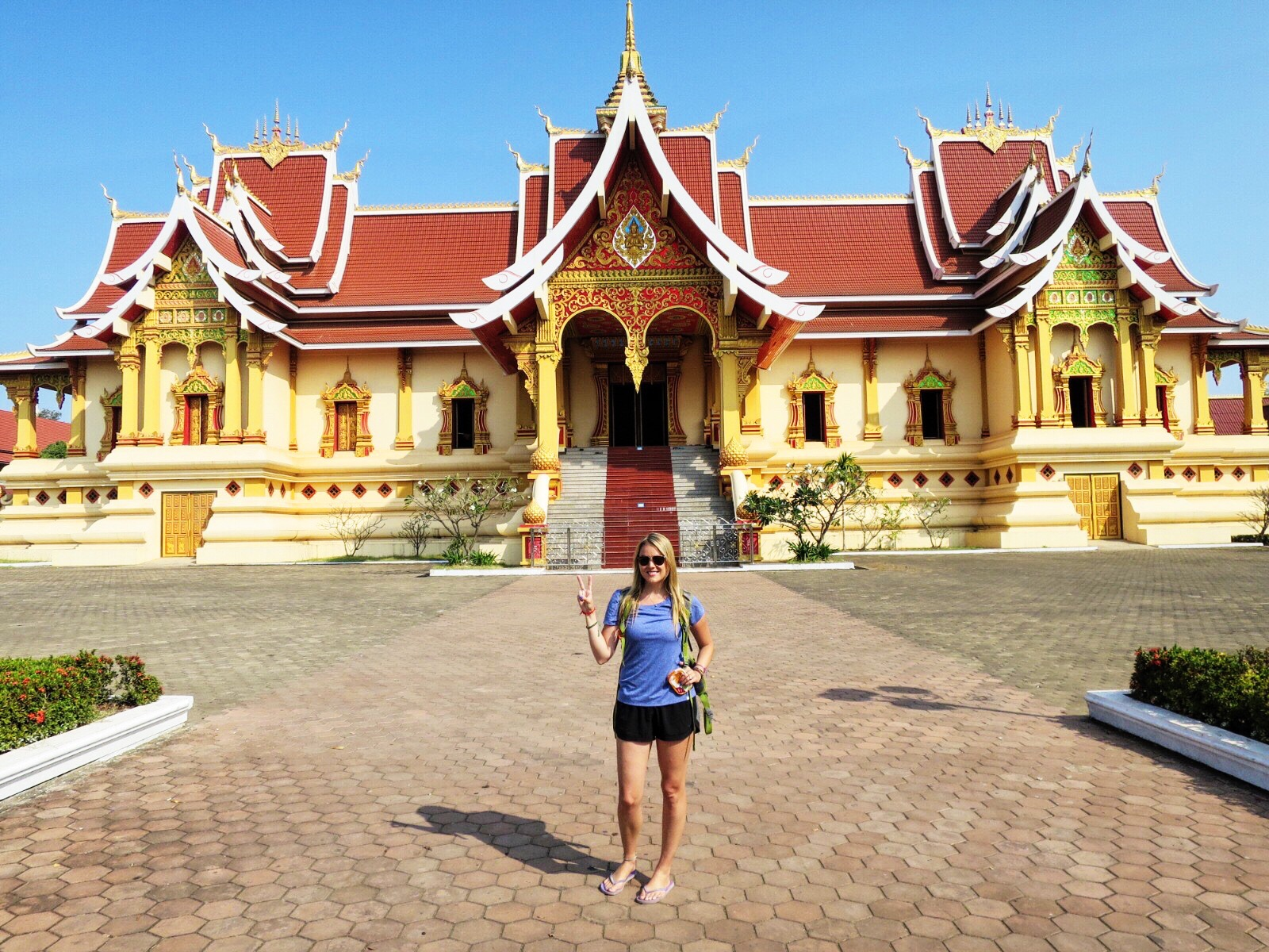 We rented bikes & rode to Pha That Luang, a Buddhist stupa in the capital of Laos.