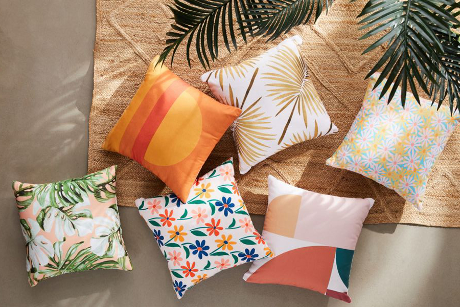 Your outdoor space will feel so breezy with this durable poly throw pillow, printed with a minimalist palm print by Cat Coquillette.