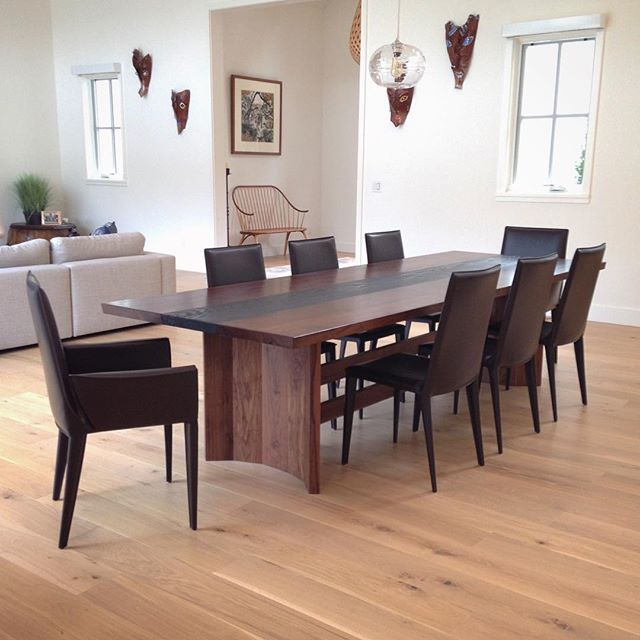 The Fireside Dining Table paired with Bottega chairs from @designwithinreach. This ten-foot long custom table is made of California claro walnut and scorched white oak. Lookin' pretty swag in its new abode! 😎 #jawwoodshop #firesidecollection #customfurniture