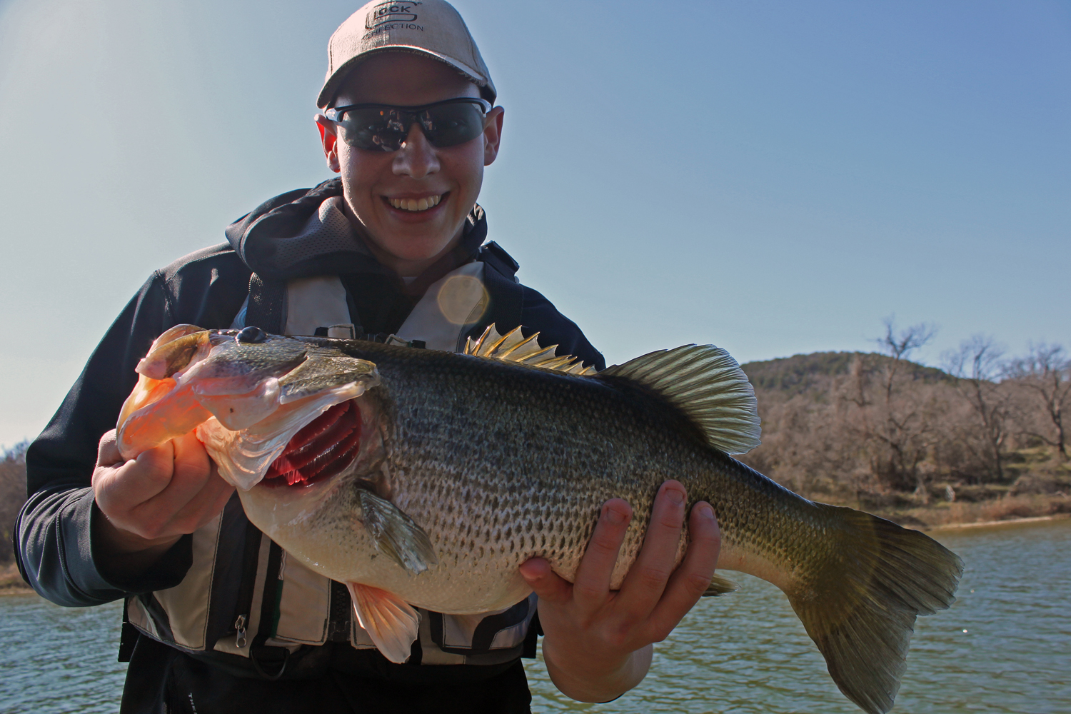 Clint Taylor with a 12-pound bass on the Brazos River
