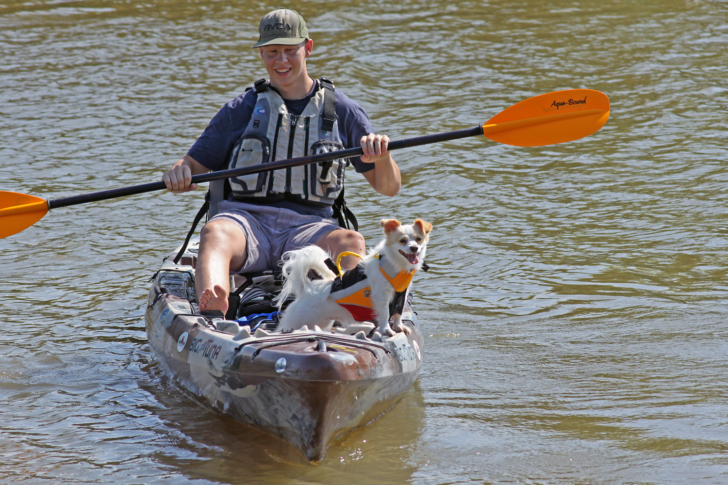 Clint Taylor with his dog Pup in the Jackson Kayak Big Tuna with MTI Adventurewear life jackets