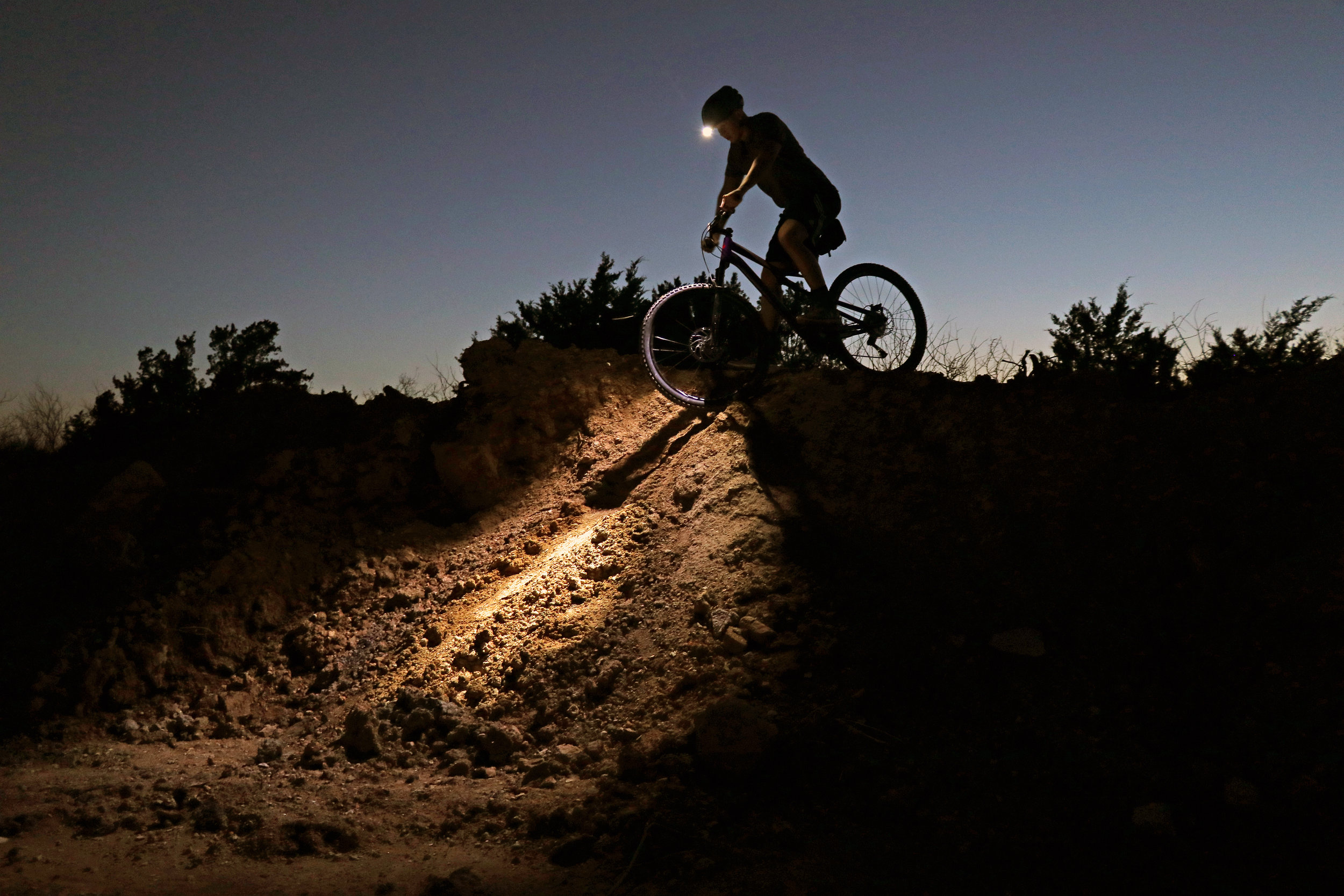 Clint Taylor with his Coast FL78R headlamp and Specialized Comp 29 mountain bike