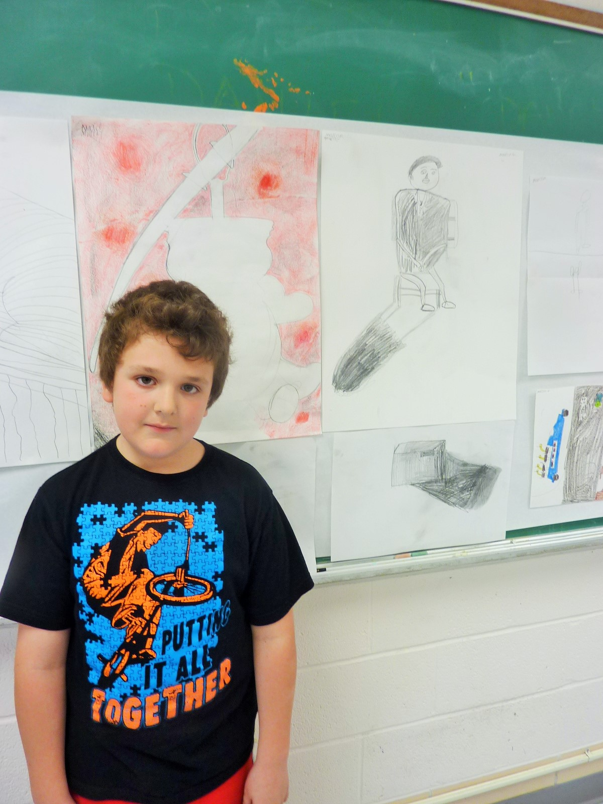 Marco was his best critic in the drawing class, his facial expression says it all!
