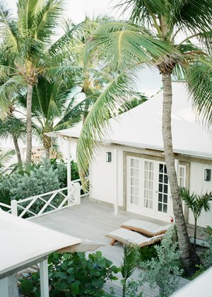 fine+art+photo+of+white+beach+cabana+with+palm+trees.jpg