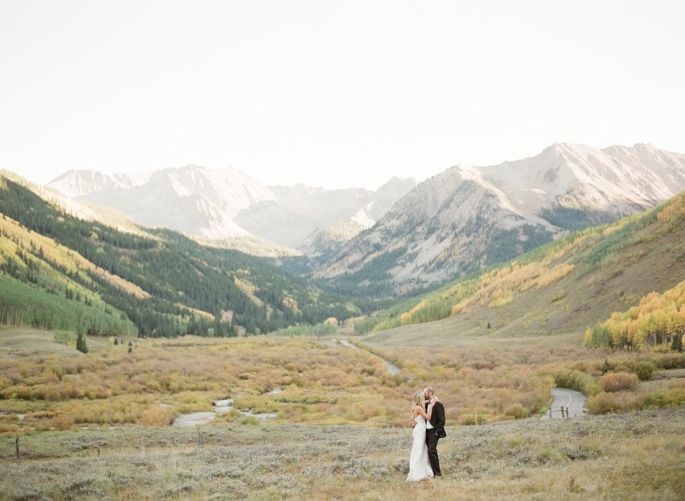 fine+art+photo+of+bride+and+groom+kissing+in+mountains+with+fall+foliage.jpg
