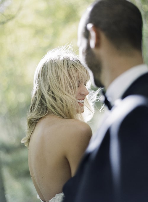 fine+art+photo+of+bride+and+groom+laughing+bride+has+low+back+dress.jpg