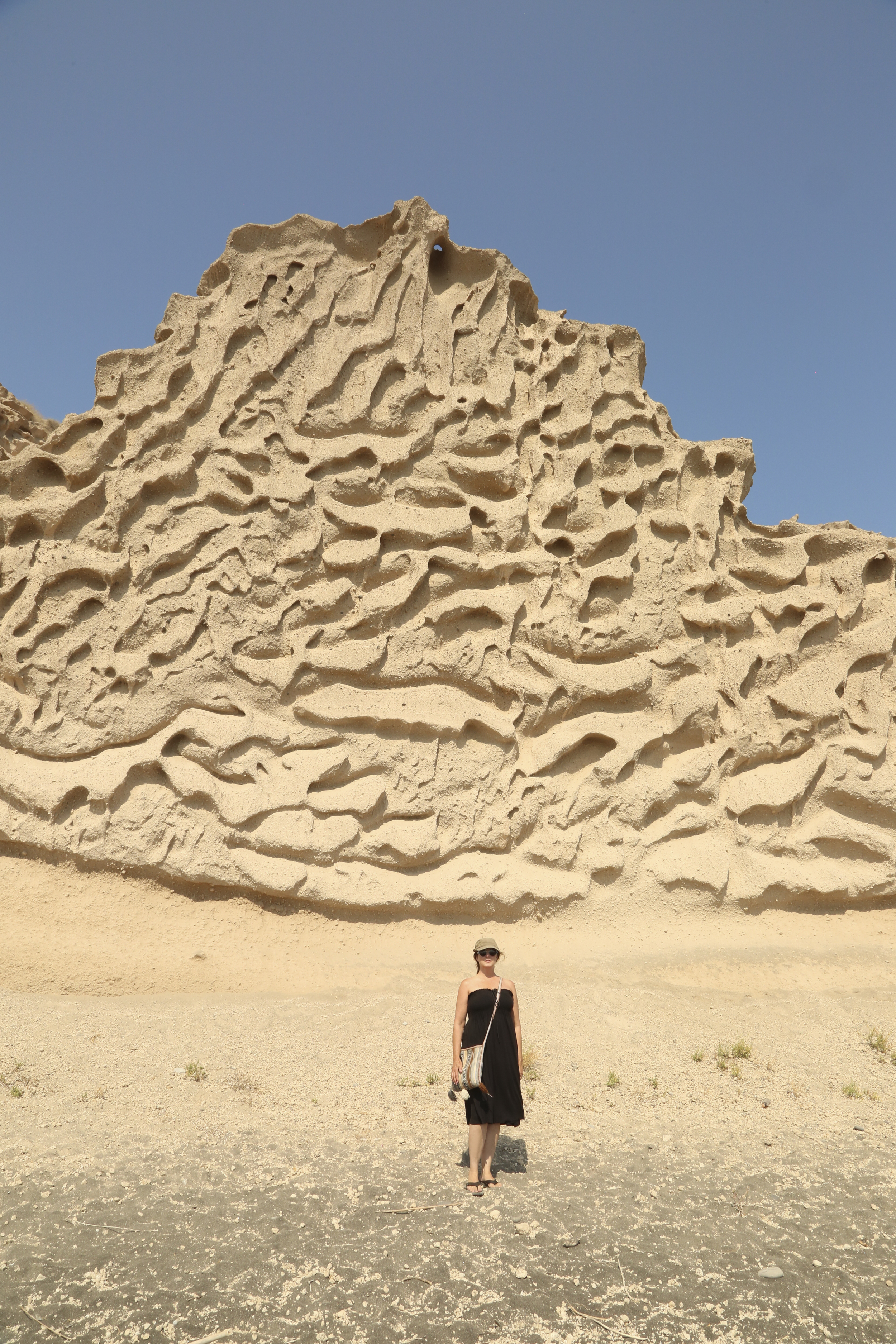 Michelle Larson   – On the island of Santorini, the wind has carved the sand hillsides into textured walls. Nature's art fascinates me.