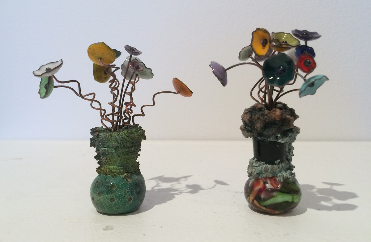 "D. Lynne Bowland, ""Flower Power 1 & 2"", flame glass vases with enamelled flowers, 8H x 6W x 6D cm. A reference to the 1960s and 70's flower power generation."