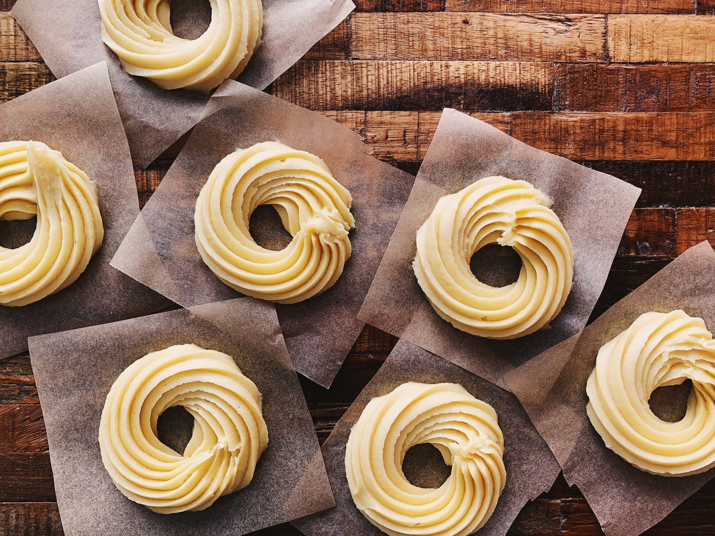 The crullers will be piped onto a square piece of parchment paper for easy transfer into the hot oil.