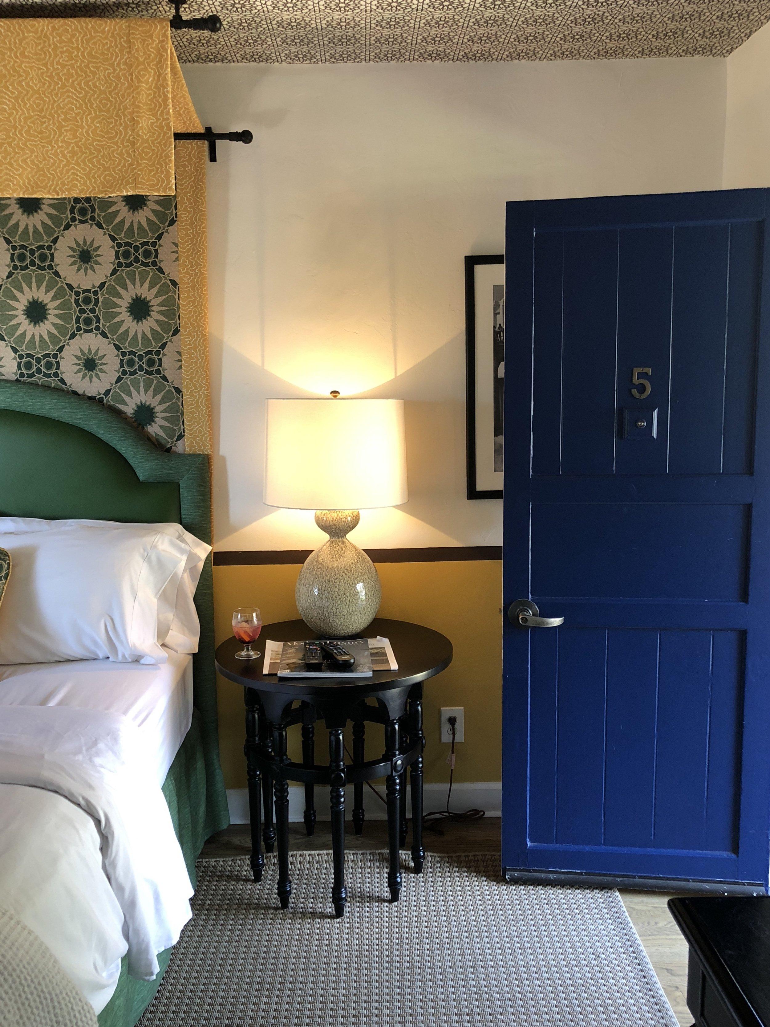 casa laguna's cobalt blue door open in the bedroom