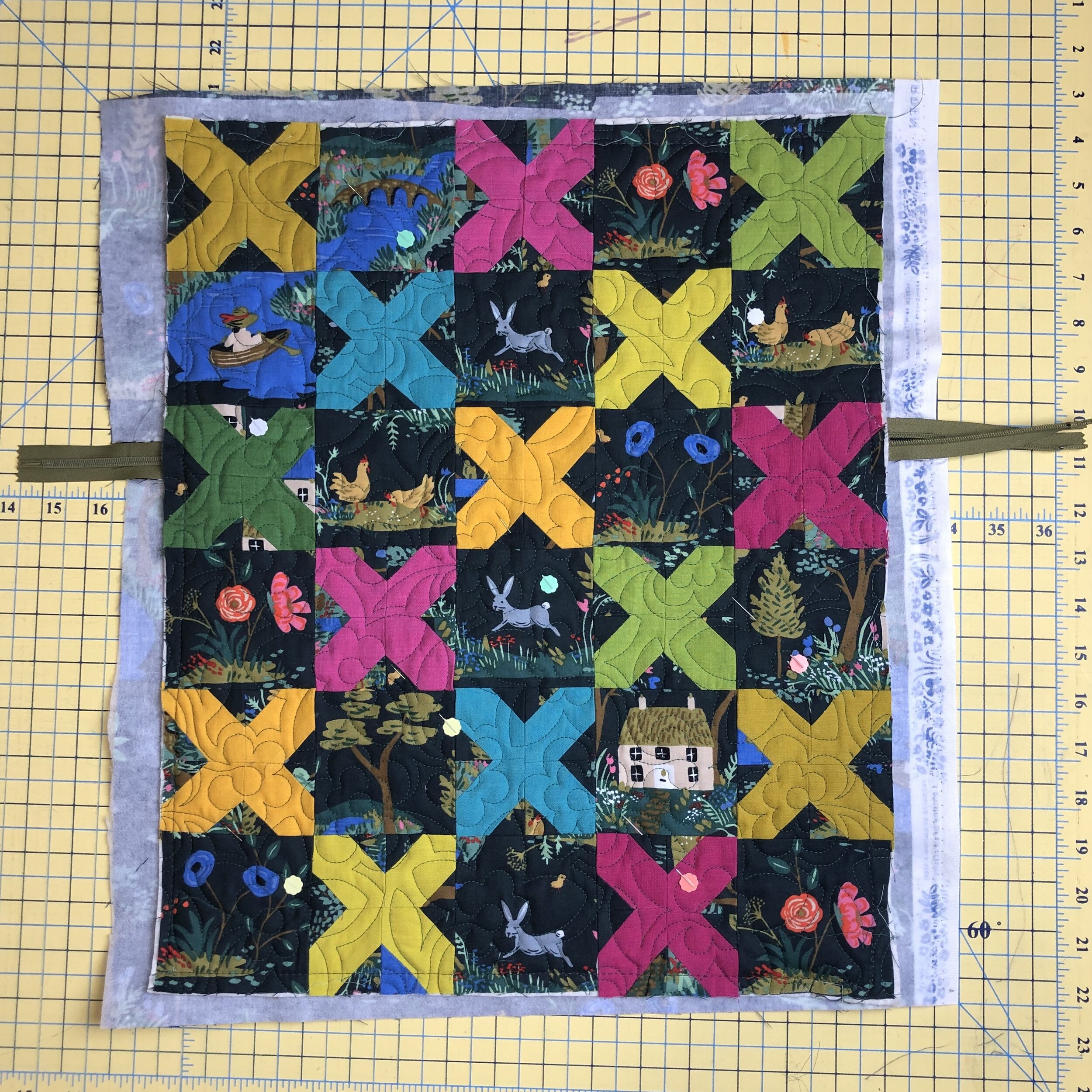 - 4. Sew around all 4 sides with a basting stitch. This doesn't need to be beautiful or at a set distance from the edge- it just needs to hold everything so you can bind without struggling. You will remove it later.