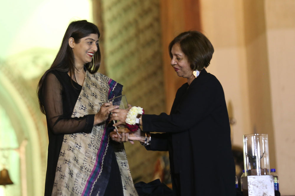 Ammara Jabbar being awarded the 2018 Imran Mir Art Prize by Chairperson of the IMAF, Nighat MIr