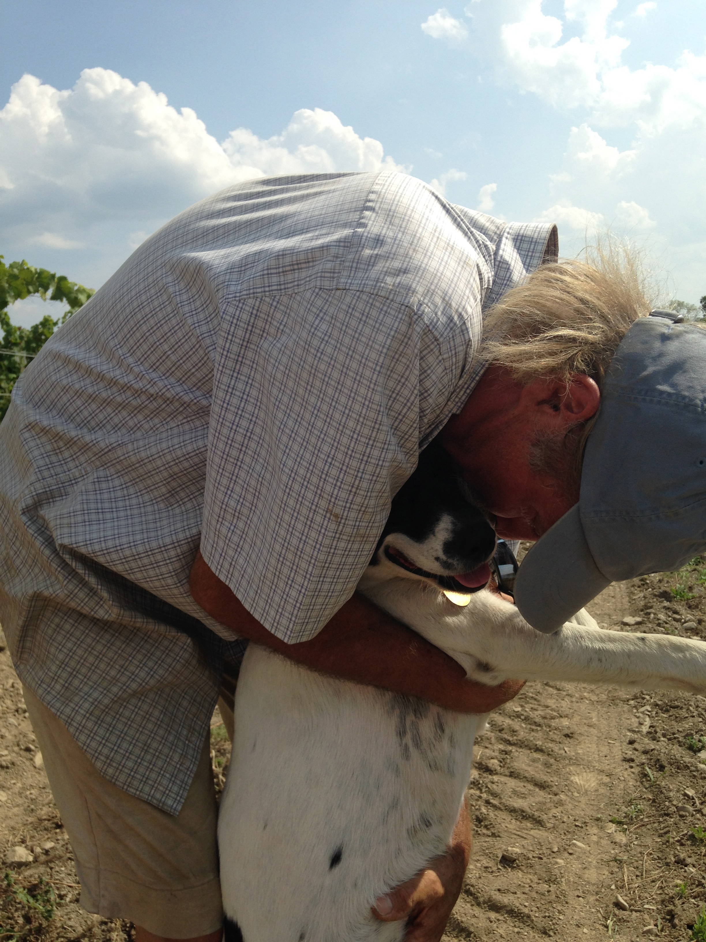 Bloomer Creek's Kim Engle with lucky vineyard dog, Odie