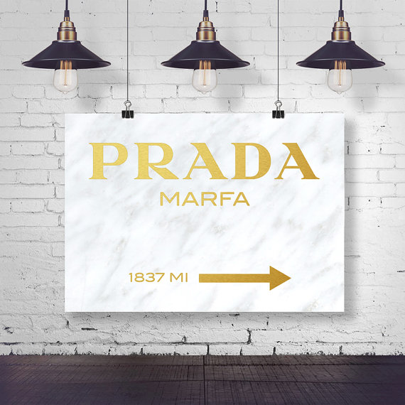 A marble and gold poster version of the prada marfa sign available from  macarons & Mimosas