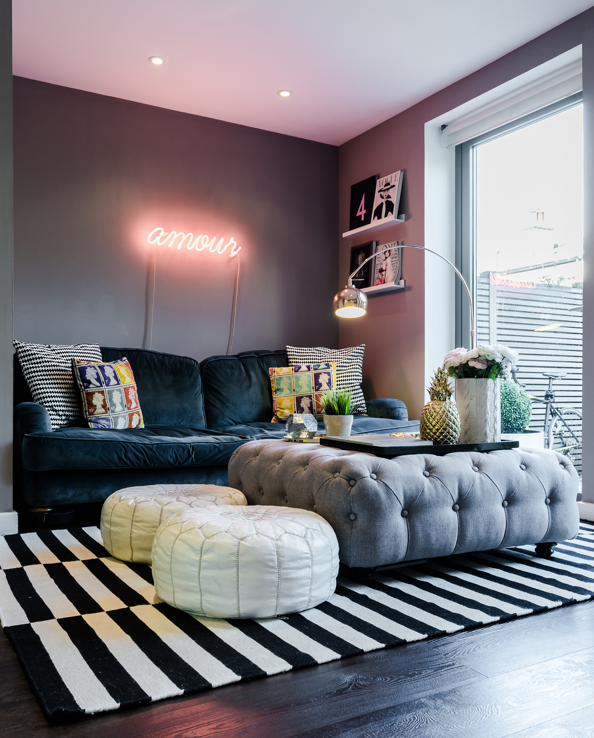 My pad in London, full of bright colours, dark walls, with its velvety sofa, golden pineapple and all.