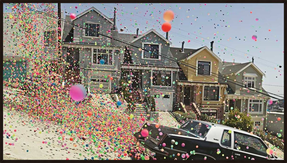I feel head over heels with Danish photographer Peter Funch's shots taken during the Sony TV advert where 250,000 multicoloured balls were let loose in the streets of San Francisco.