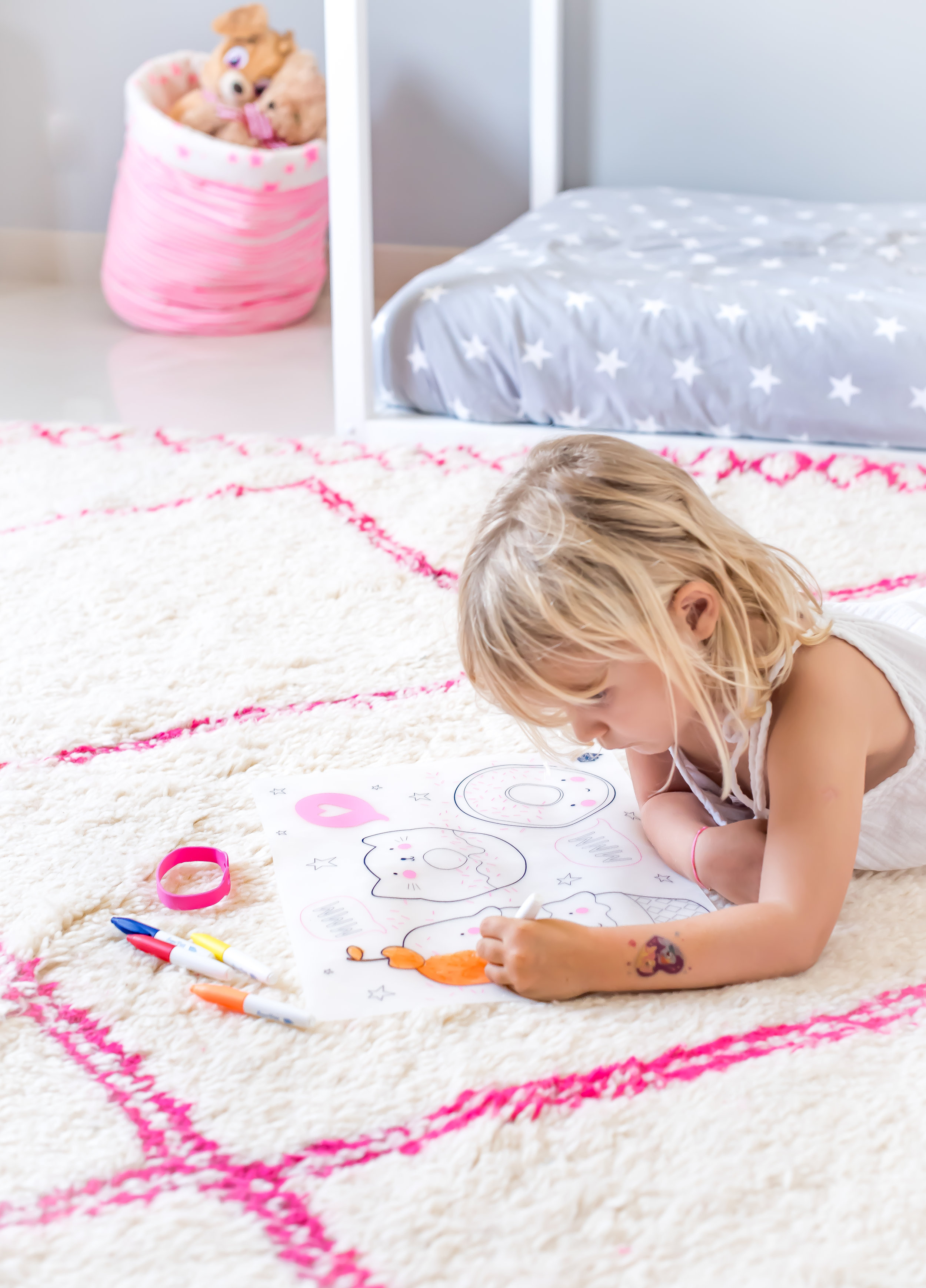 Stella in deep concentration with her colouring placemat...photo credit:  Karen Pissarra @designk