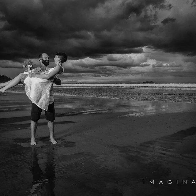 Get married on the beach at sunset before a tropical rain shower. 💝