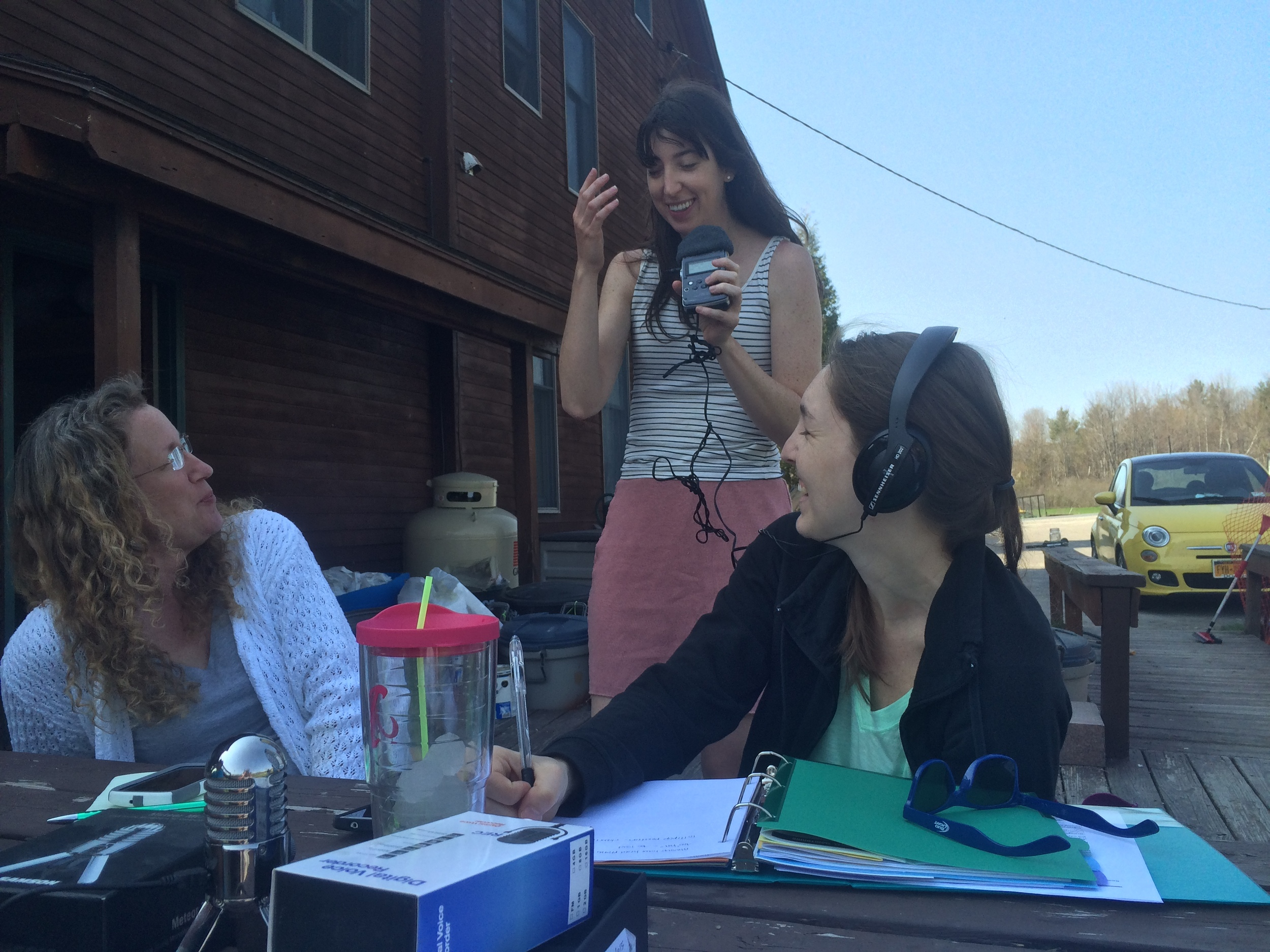 Julia Botero of NCPR, center, instructs betterArts board members Eileen Kaleel, left, and Ashley Pastorius on basics of sound engineering.
