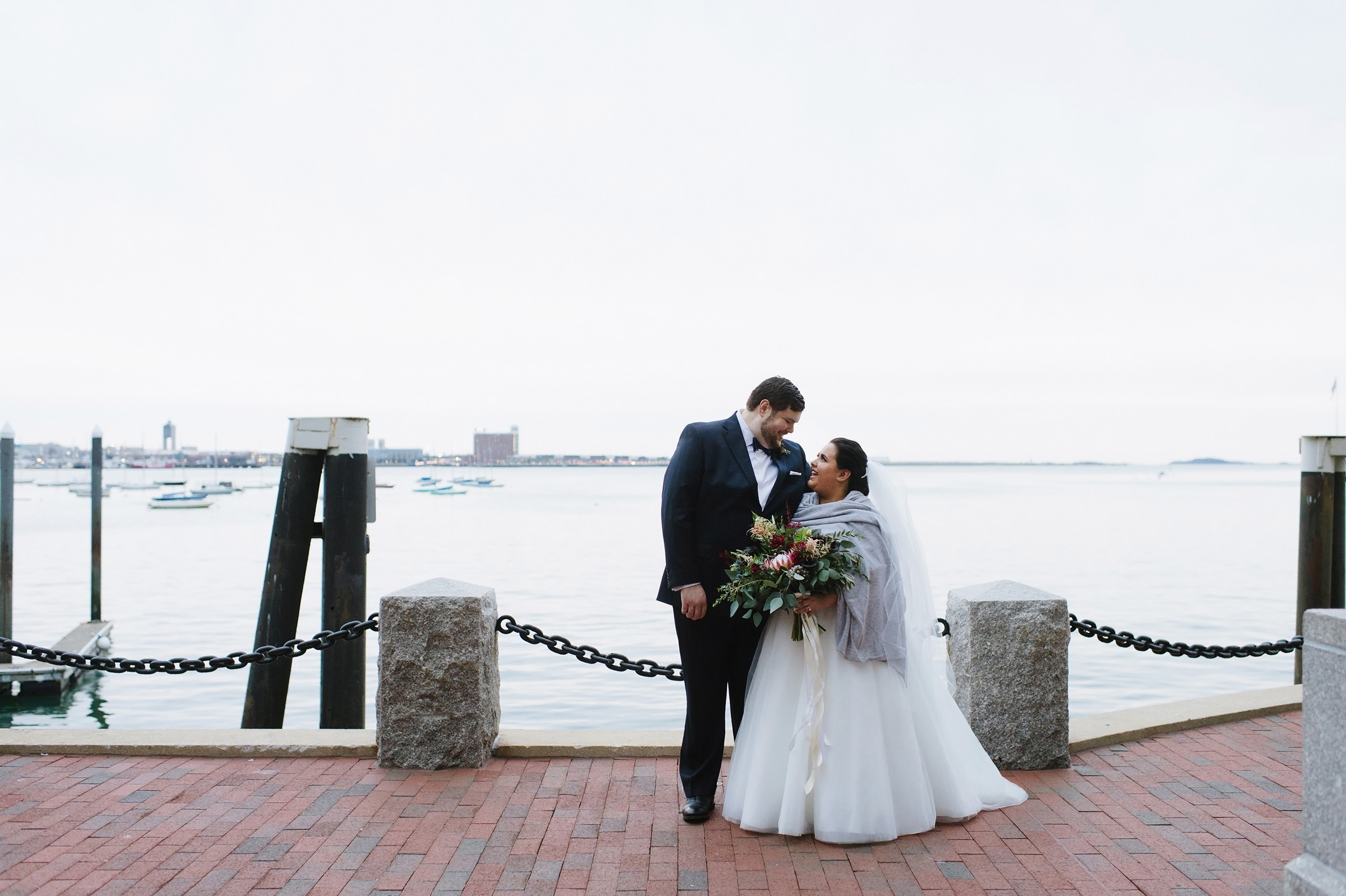 Couple standing at the Boston Waterfront on their wedding day