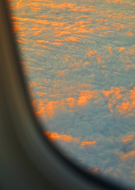 CloudsPlaneWindow_10in.jpg