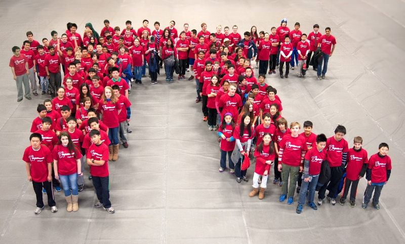 MATHCOUNTS mathletes form the symbol for pi at the Massachusetts state competition. (PRNewsFoto/Raytheon Company)