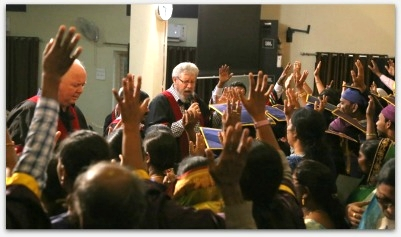 Chris Peterson Praying for the International School of missions graduates at the Hyderabad campus. Around 70 graduated all engaged in Church planting.