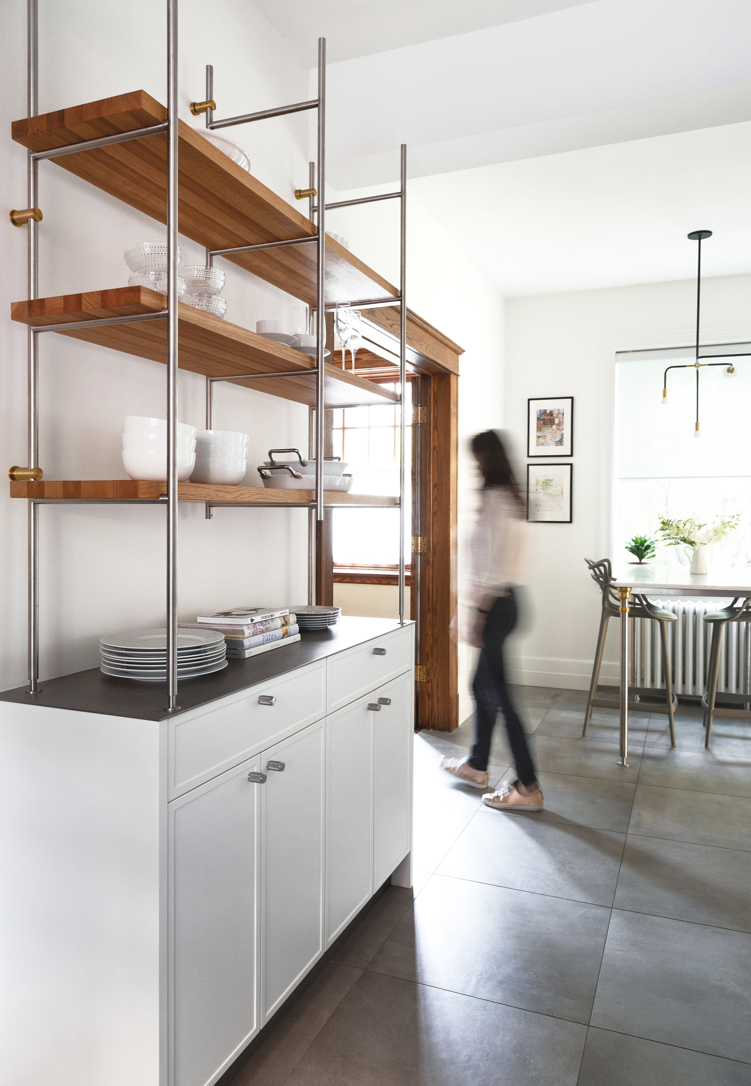 1 - Take advantage of a vertical wall - Place the items that are useful on a daily basis on open shelves and conceal the items that should be hidden in the drawers and cabinets below and voila! Along a bare wall (as we did here) or in front of a decorative wall covering, you get a look that is both versatile and uncluttered.