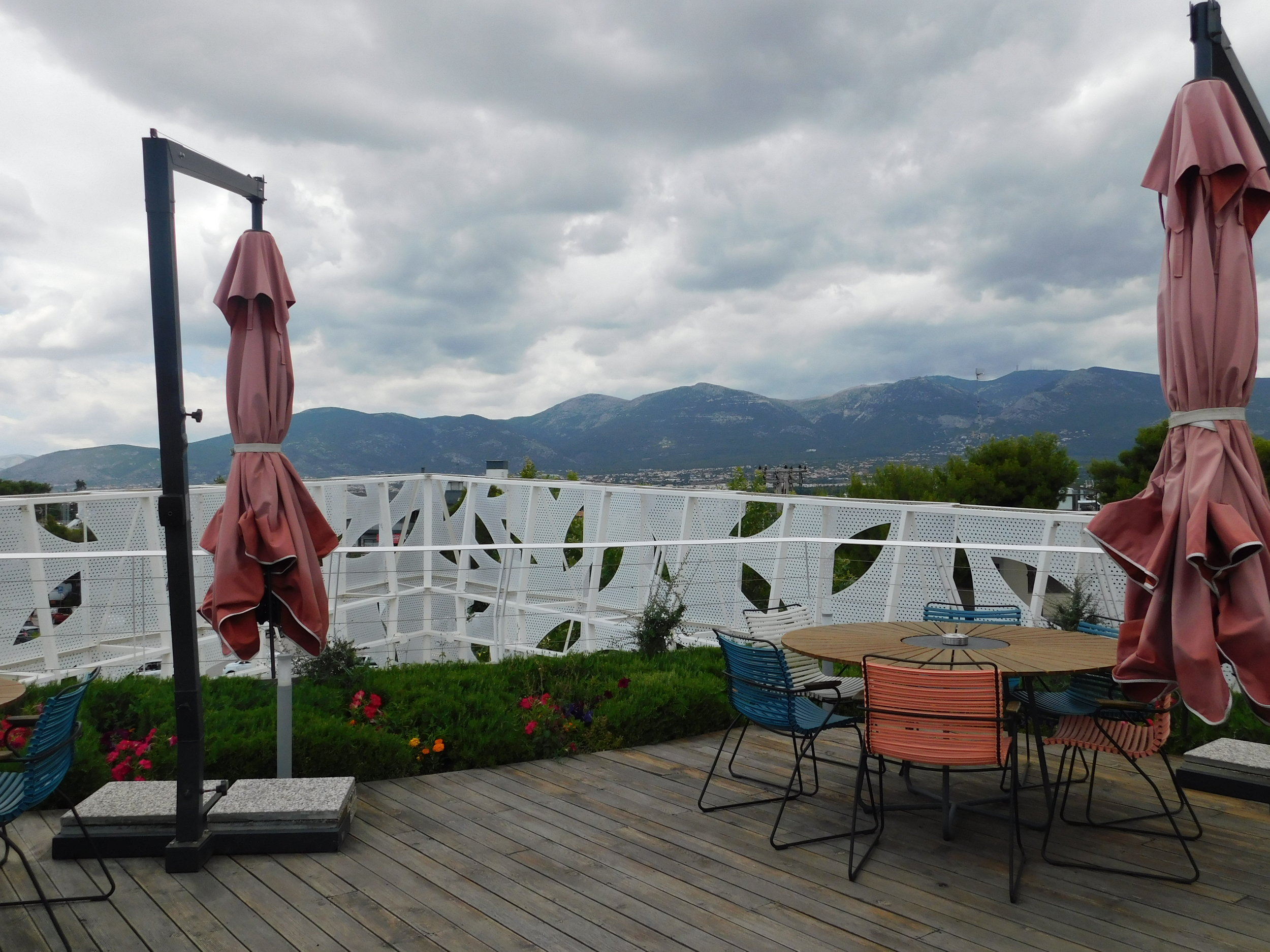 View from the large, roof top patio offering views of nearby mountains.