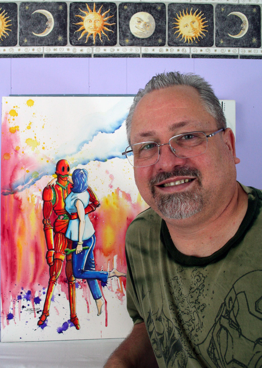Artist Jay Larsen with one of his Retro Robot Watercolor Paintings.
