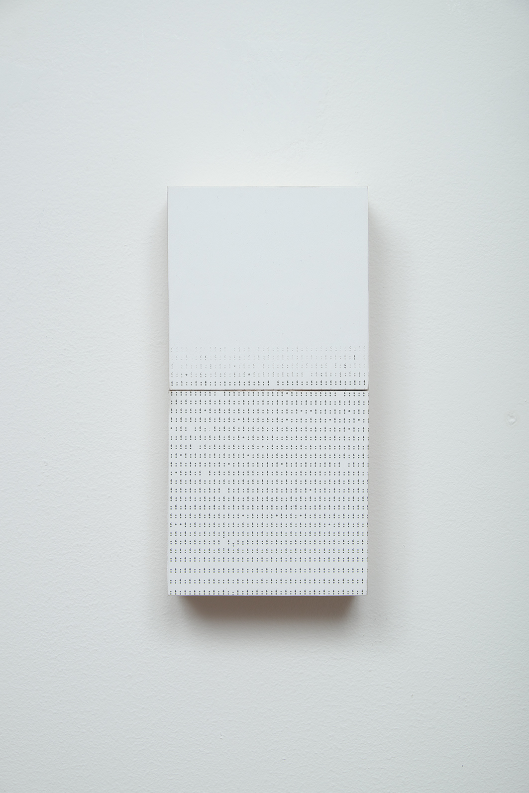 Nothing to Say. 2010  Ink on paper, typed on typewriter, mounted on wood.(see sculpture)