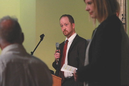 Fitchburg mayoral candidate Andrew Couture takes a question during a downtown forum with fellow candidate state Rep. Stephen DiNatale Thursday night. SENTINEL & ENTERPRISE / JOHN LOVE  Sentinel and Enterprise staff photos can be ordered by visiting our  SmugMug  site.