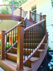 Curved Trex Transcend Stair railing and Curved Laminated Stair Stringers. Installed by Highland Renovations in Maryland.