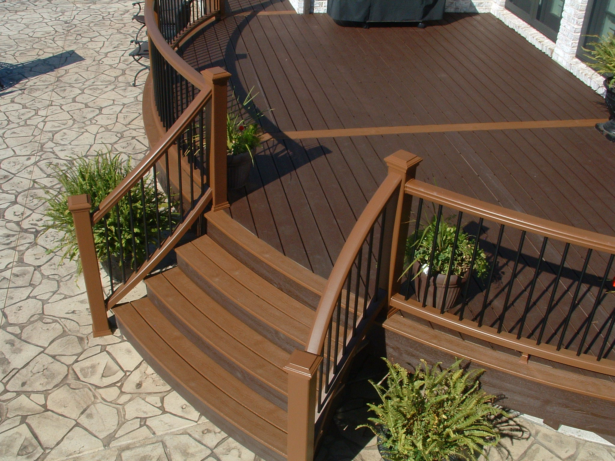 Curved Trex Transcend Railing and Decking installed by Bugh, Inc. in OH