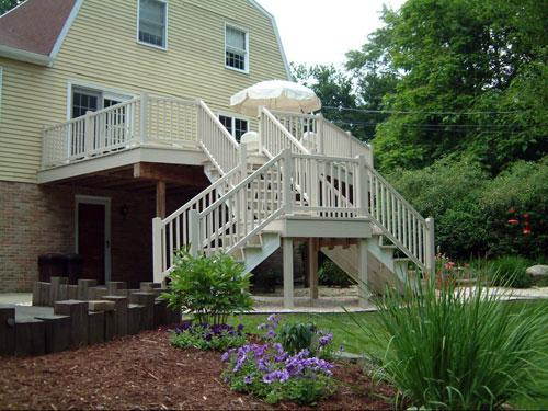 vinyl-deck-that-goes-down-to-a-landing-with-two-sets-of-steps.jpg