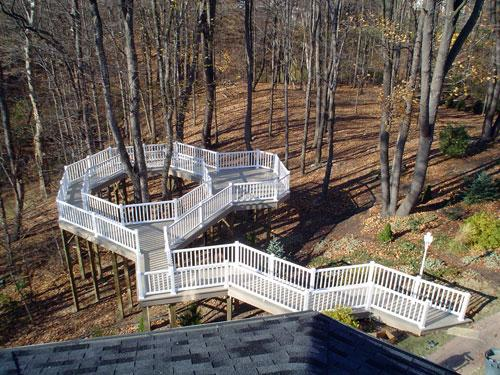 vinyl-deck-surrounds-trees-with-a-bump-out.jpg