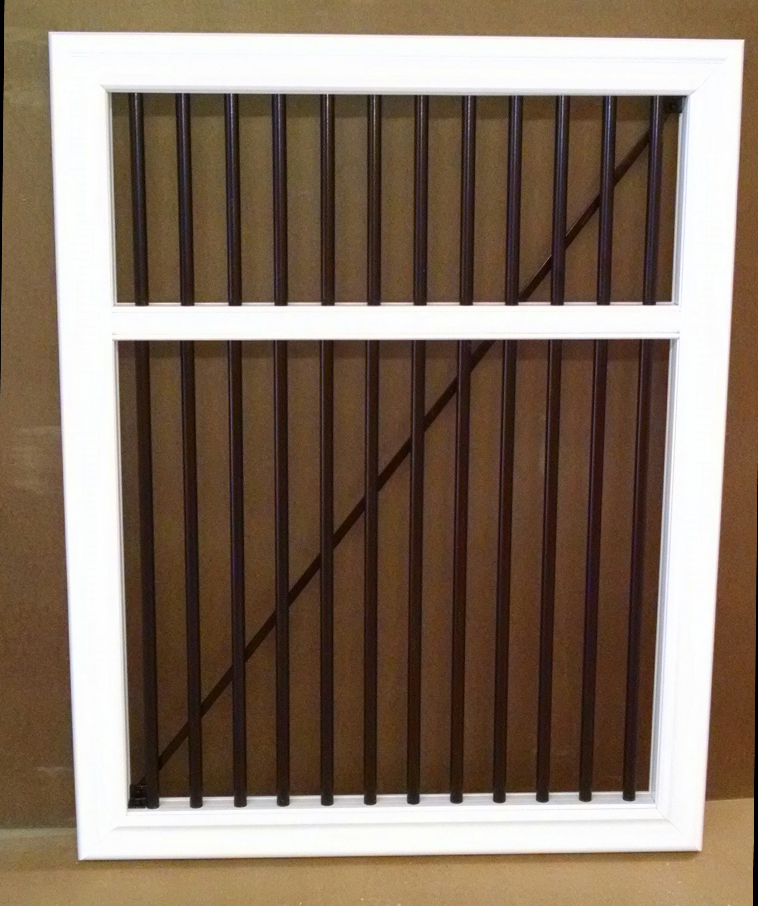 TimberTech RadianceRail Gate 46in tall with Mid-rail, black round balusters at a closer spacing.