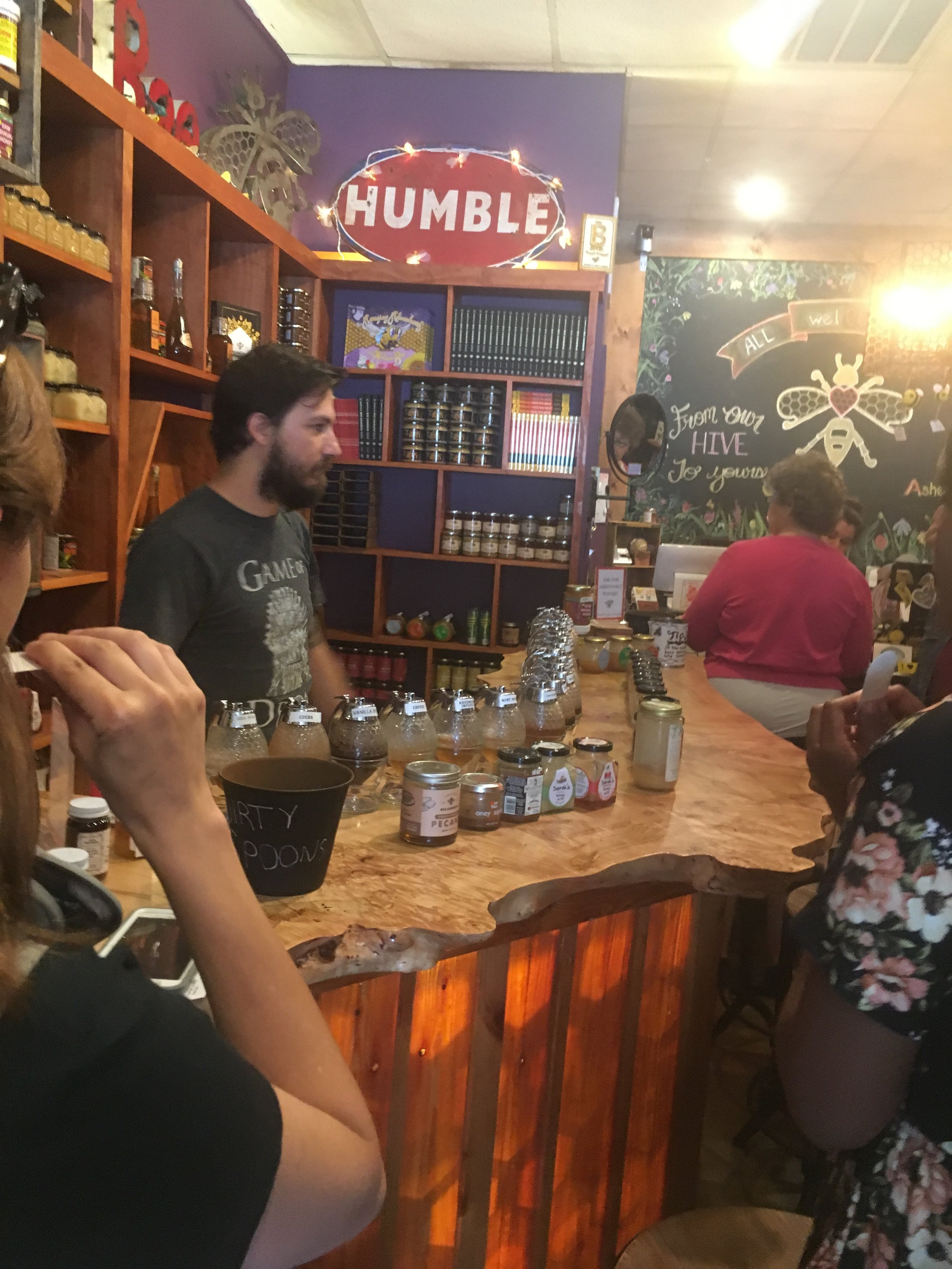 Honey tasting bar complete with a staff member to assist you with all your sampling needs.