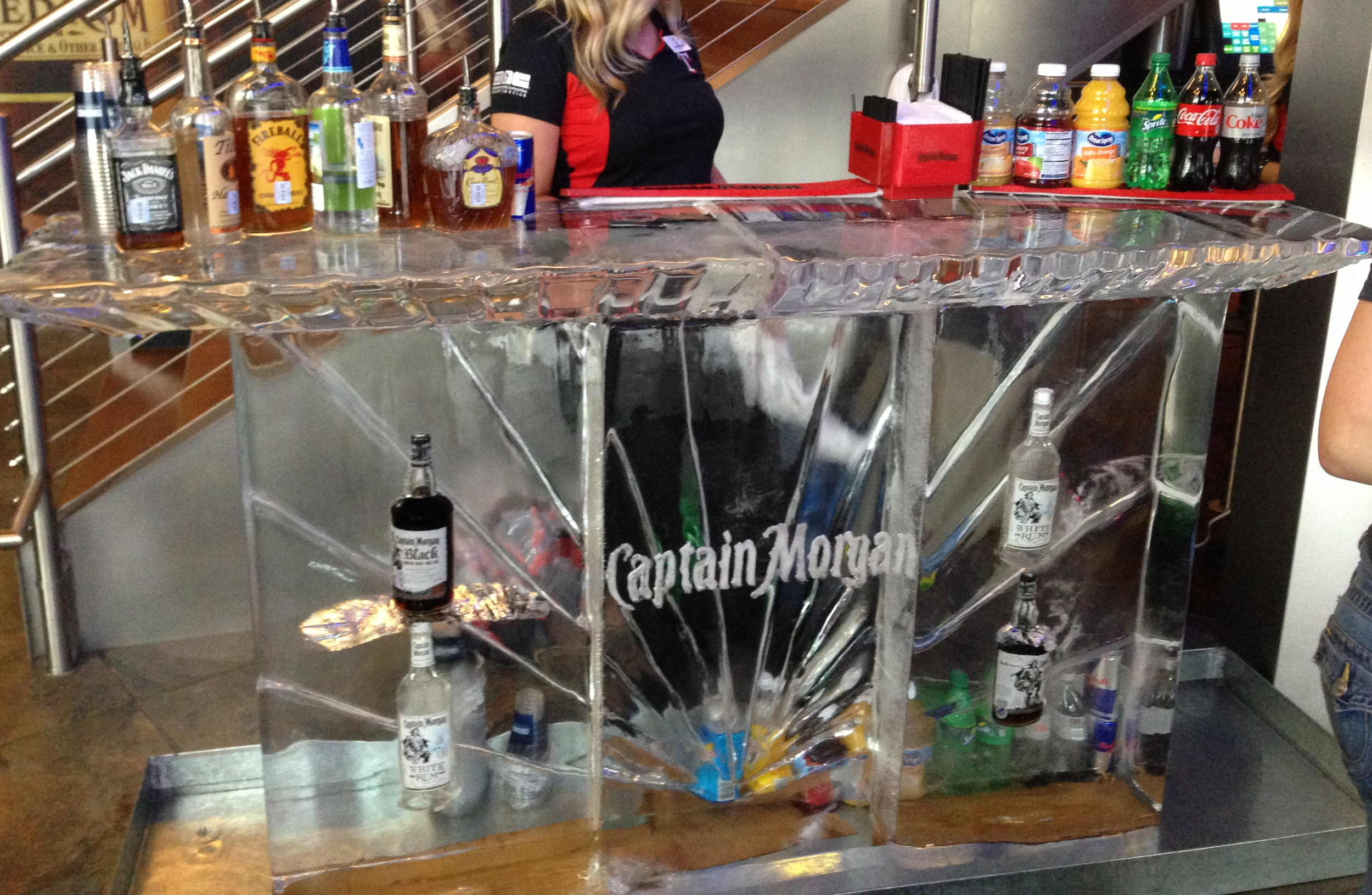 Ice bar with bottles frozen in