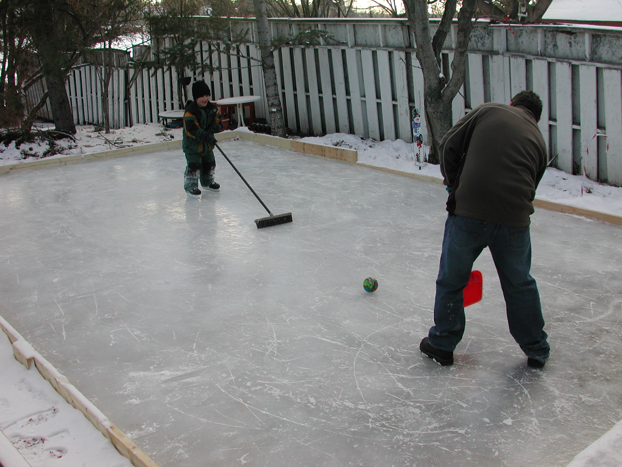 Aaron had just learned to skate on his own, playing a form of Broomball with his Uncle Kevin.