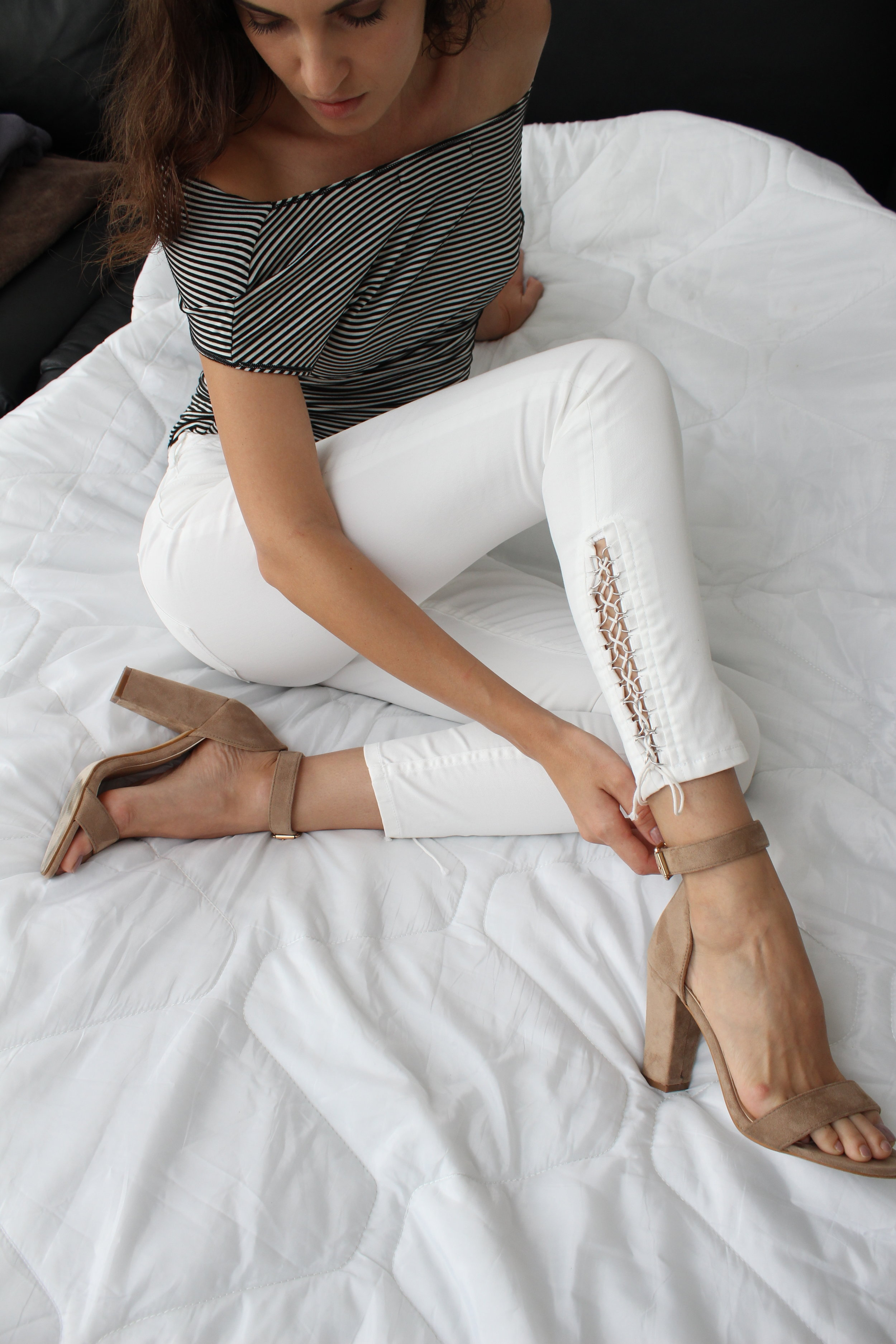 Red slim fit trousers on white sheet fashion photography