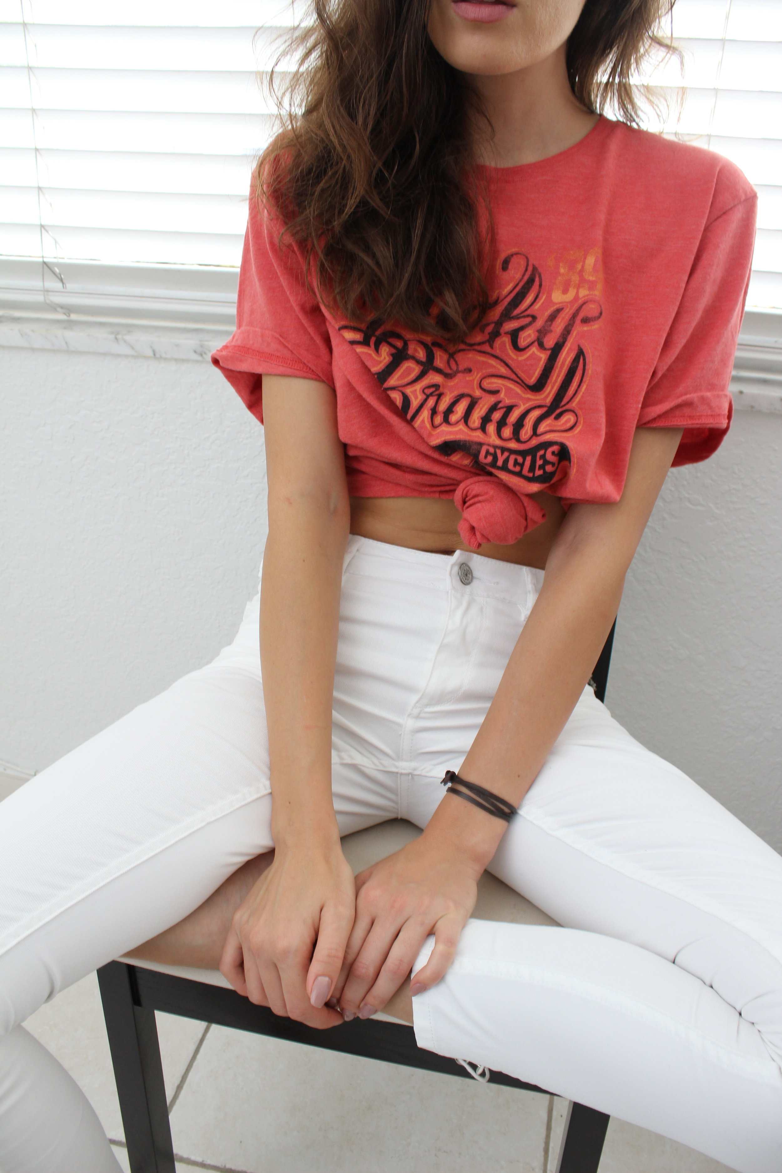 Red T-shirt white trousers fashion close-up photo