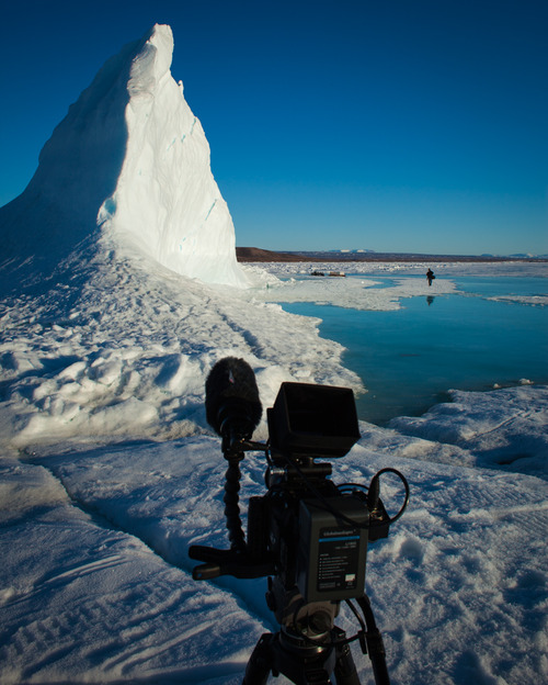Filming an Ice Berg where the locals gather ice for fresh water.