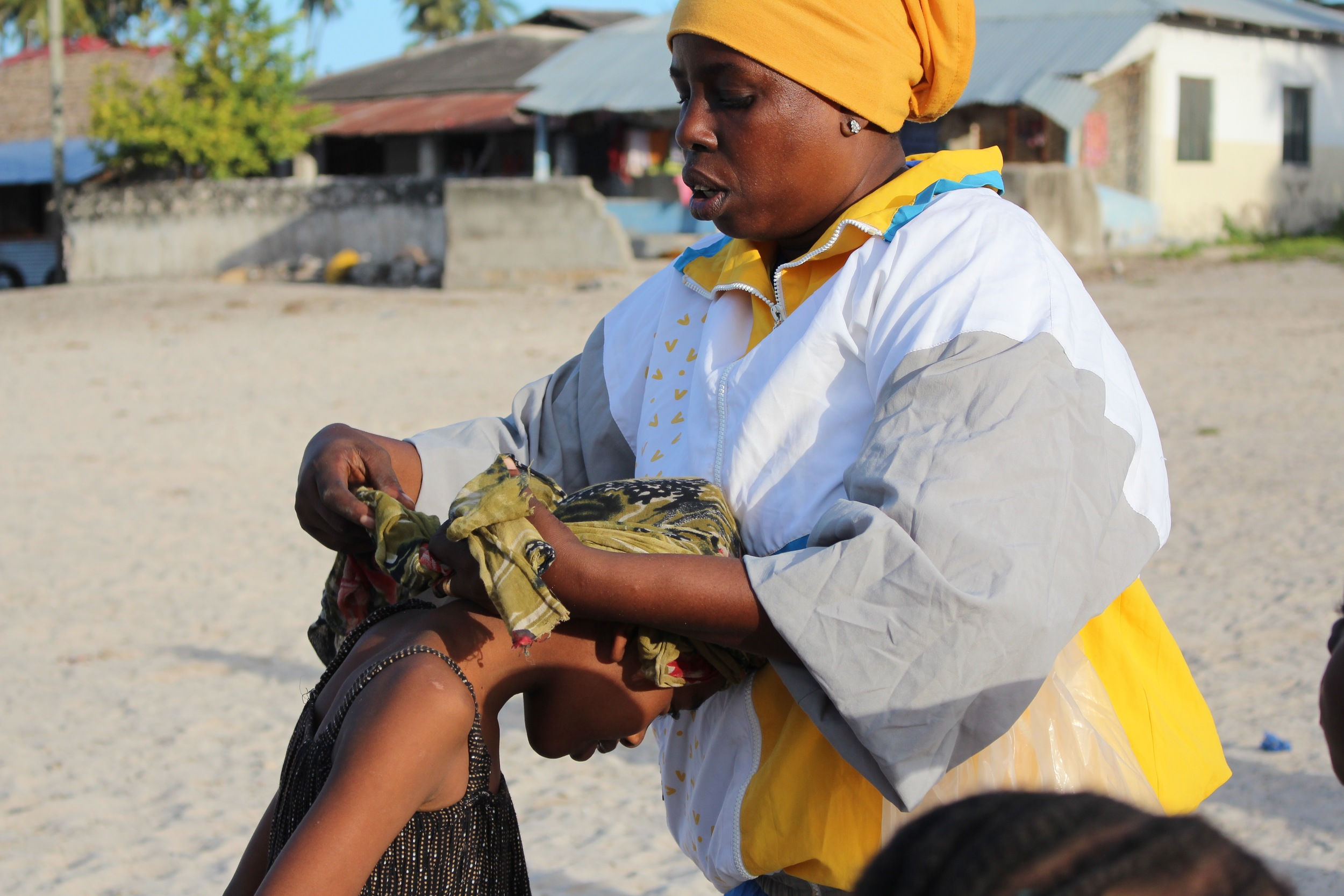 Bettina tying up a headscarf in Paje, July 2015