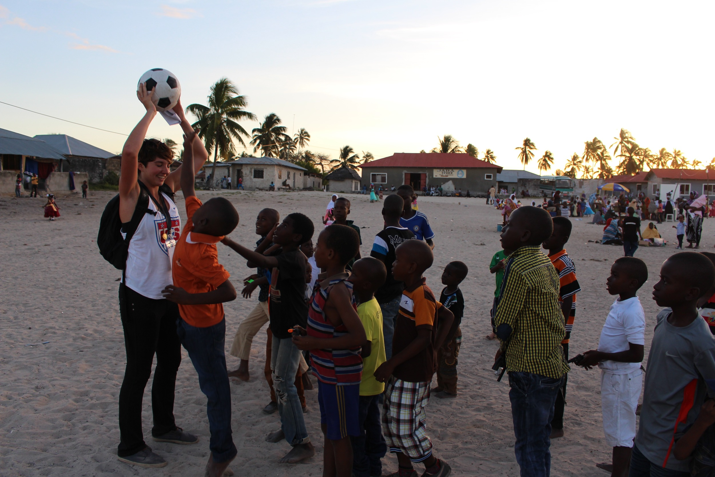 Megan playing soccer with Paje boys