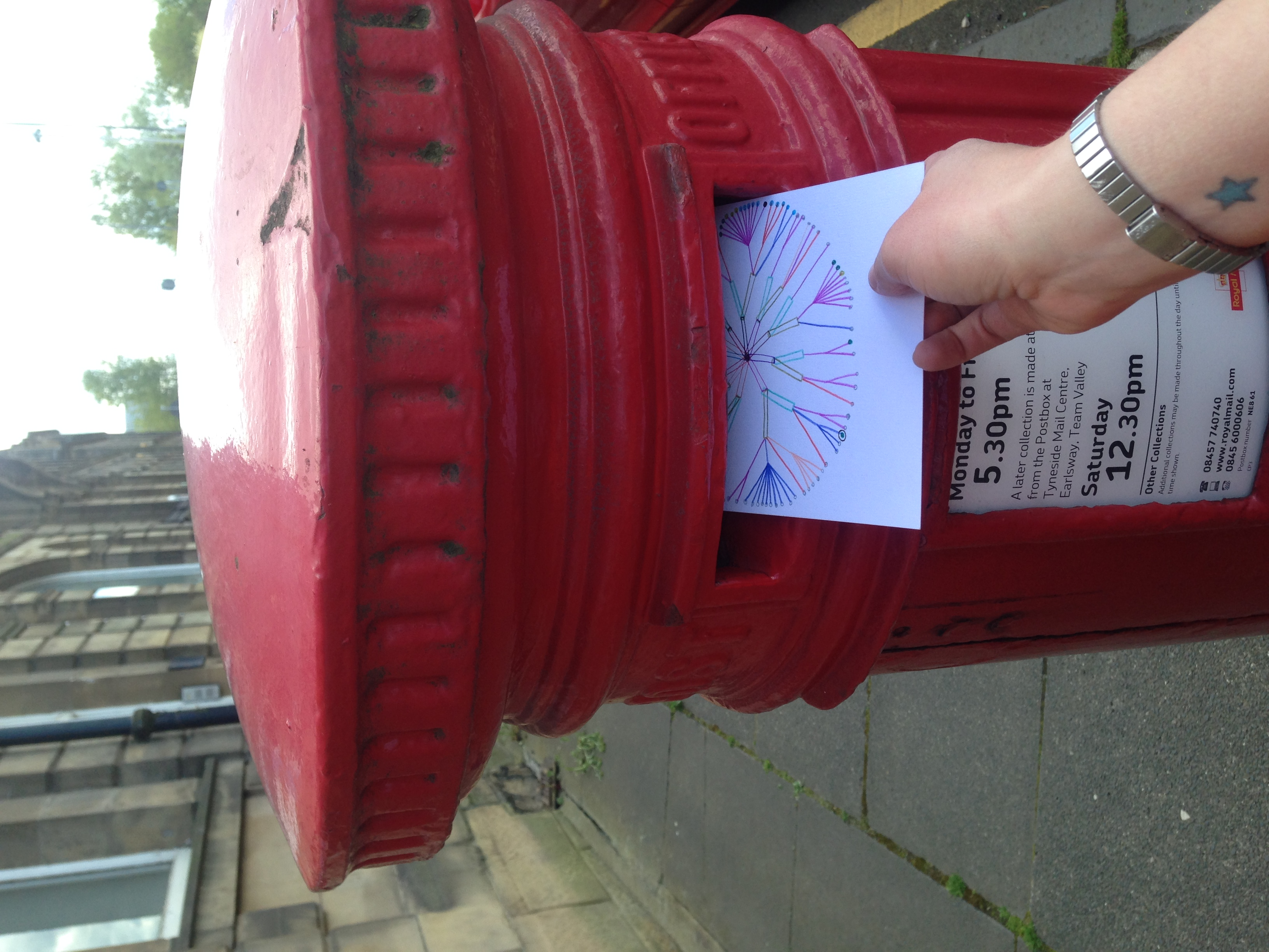 Posting the second card while on a trip to Newcastle